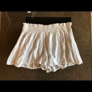 Flowy white beach shorts
